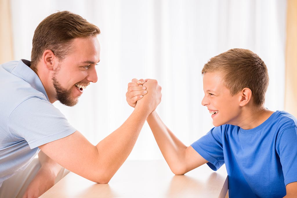 Big and little arm wrestling